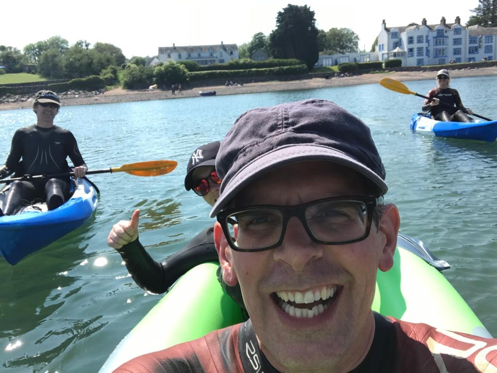 Kayaking with friends on Balcary Bay