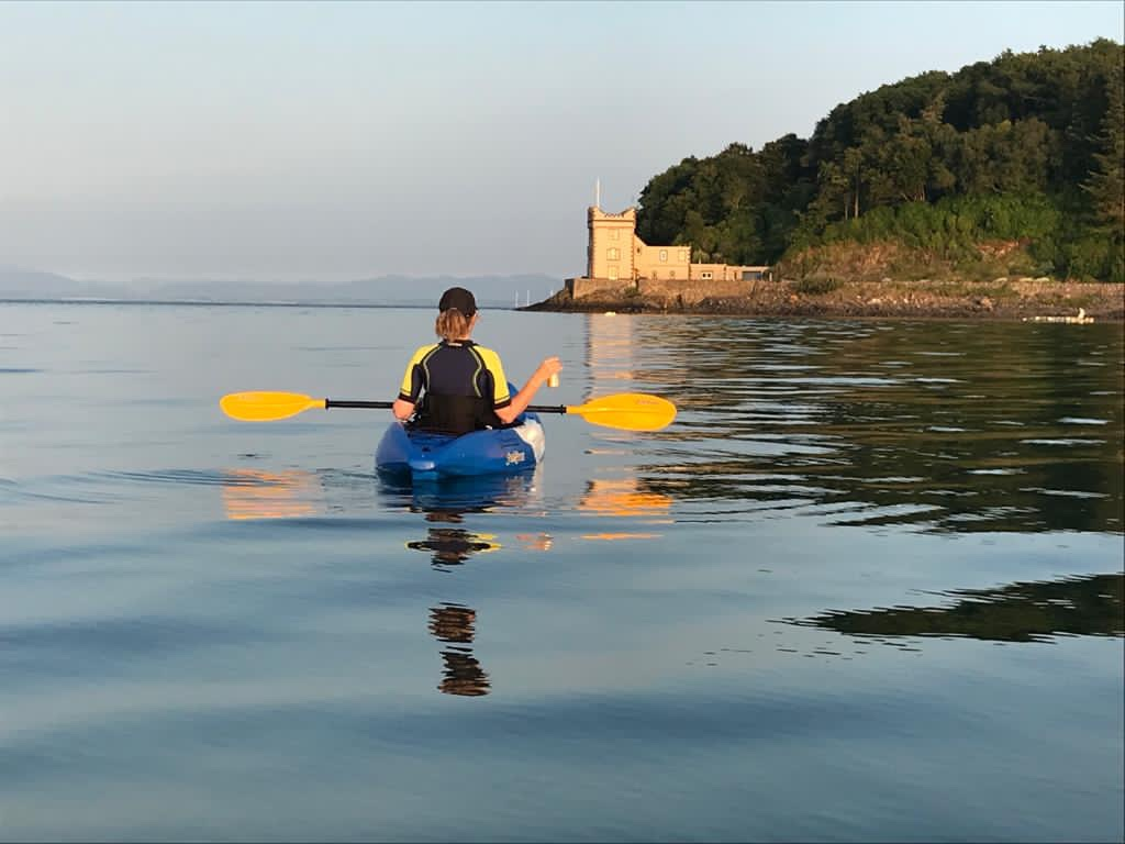 Kayaking with Balcary Tower in the background
